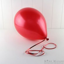 Metallic Red Balloons you can fill with helium or air.