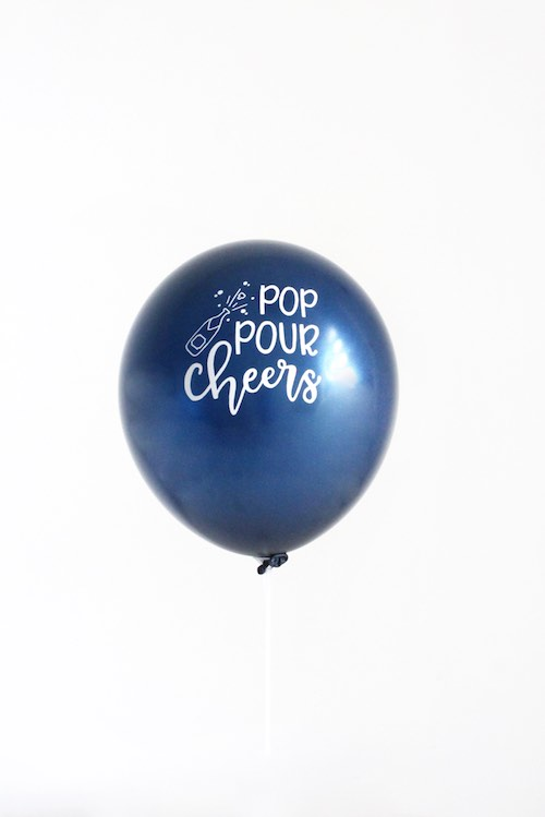 Our Pop Pour Cheers Balloons are metallic navy with white matt ink.