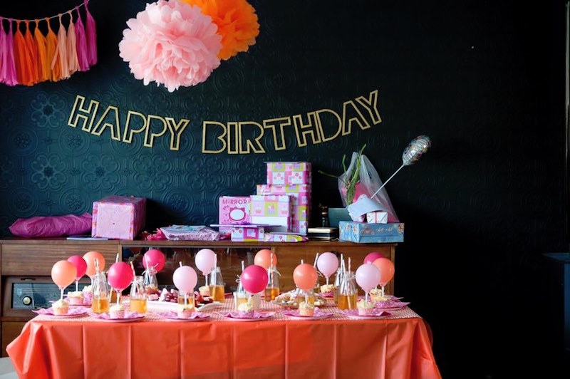 A kids birthday party featuring pink, orange and gold colours.
