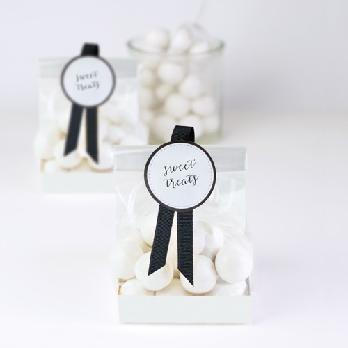 White treat bags by Paper Eskimo make fabulous wedding favours.