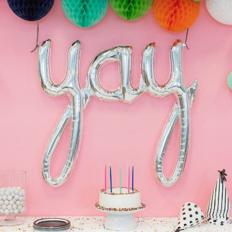 Silver yay script foil balloon by North Star Balloons. Letter and word balloons available in NZ.